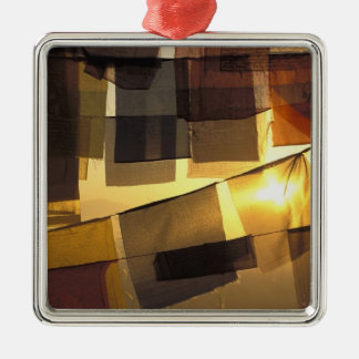 Buddhist prayer flags in the sunset, metal ornament