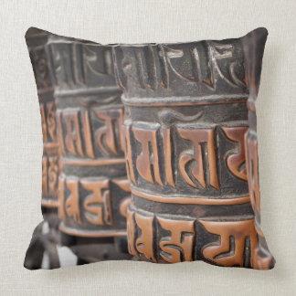 Buddhist prayer wheels throw pillows