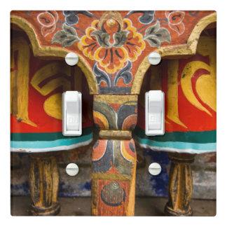 Buddhist praying role, bhutan light switch cover