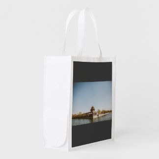 Buddhit monarchy at bank of a lake reusable grocery bags