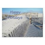Buenas fiestas dunas y cercas de arena tarjeton