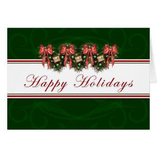 Buenas fiestas - el rojo de la guirnalda arquea la tarjeta de felicitación