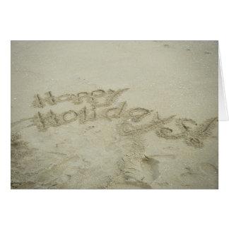¡Buenas fiestas escrito en la arena de la playa de Tarjetón