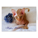 Buenas fiestas gato de la esfinge con la tarjeta a