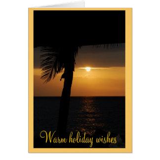 Buenas fiestas saludos tropicales de la puesta del tarjeta pequeña