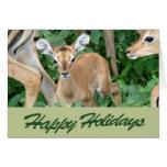 Buenas fiestas tarjeta del cervatillo del impala