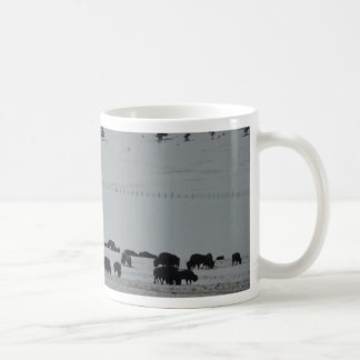 Buffalo in snow covered valley with Mountains Coffee Mug