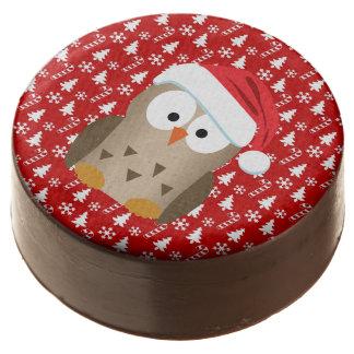 Búho del navidad con el gorra de Santa