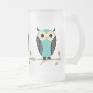 Búhos azules en el miembro taza de café