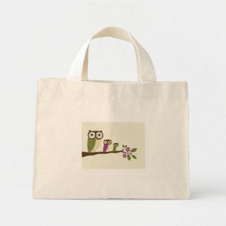 búhos en un bolso de la fila bolsa