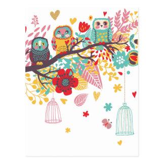 Búhos lindos y fondo floral colorido de la imagen tarjetas postales