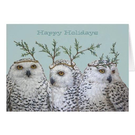 Búhos nevosos del día de fiesta en tarjeta de la a