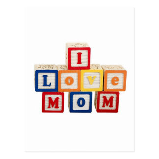 """building blocks stacked so they say, """"I love mom"""" Postcard"""