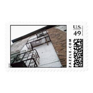 Building with fire escapes and graffiti stamp