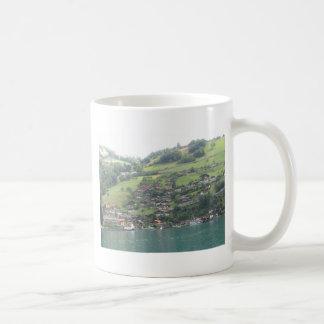 Buildings and greenery on shore of Lake Thun Coffee Mug