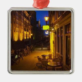 Buildings with 17th or 18th century facade and square metal christmas ornament