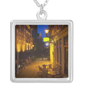 Buildings with 17th or 18th century facade and silver plated necklace
