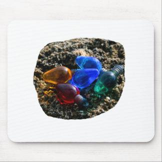 Bulbos coloridos del navidad en fotografía de la a alfombrillas de raton