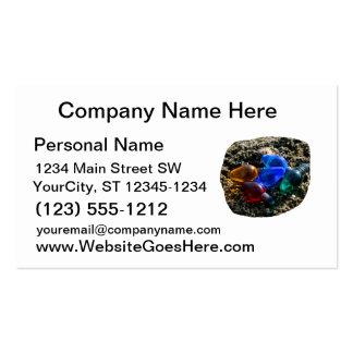 Bulbos coloridos del navidad en fotografía de la a tarjetas de negocios