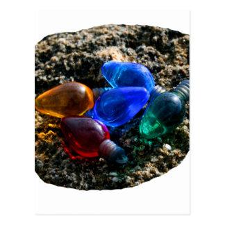 Bulbos coloridos del navidad en fotografía de la a tarjeta postal
