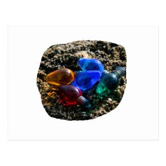Bulbos coloridos del navidad en fotografía de la a postales