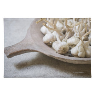 Bulbs of garlic in an earthenware bowl placemat