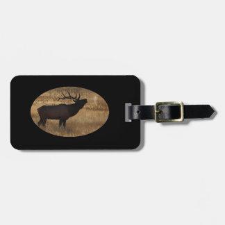 Bull elk bugling in silhouette luggage tag