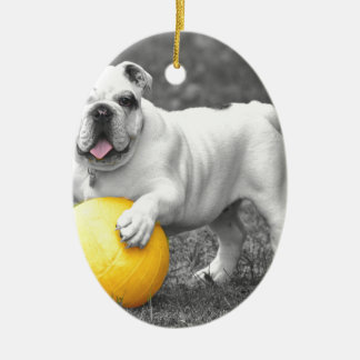 Bull in black and white with yellow ball ceramic ornament