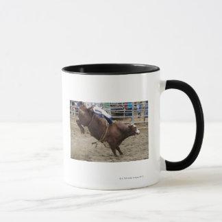 Bull rider at rodeo mug
