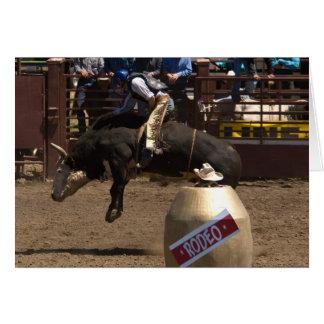 Bull rider hangs on for dear life card