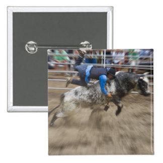 Bull rider thrown off bull button