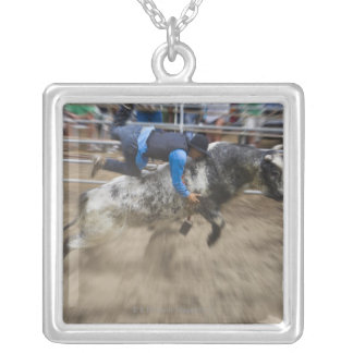 Bull rider thrown off bull silver plated necklace