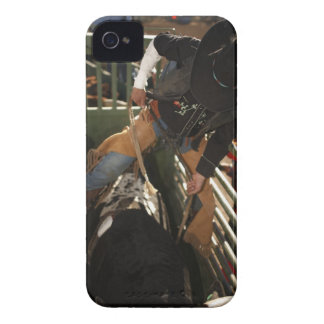 Bull rider tying rope on bull in the chute iPhone 4 cover