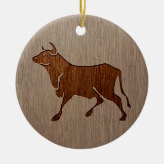 Bull silhouette engraved on wood design ceramic ornament