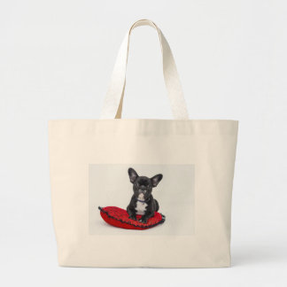 Bulldog puppy sitting on red heart shaped cushion large tote bag