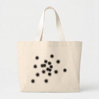 Bullet holes from a rifle or gun, possibly shotgun large tote bag