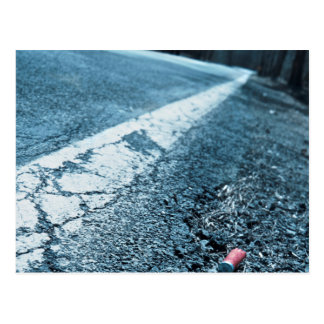 Bullet Shells on Asphalt Postcard