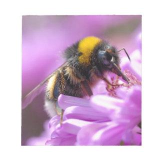 Bumblebee feeding on flower notepad