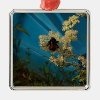 bumblebee on blue metal ornament