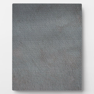 Bumpy surface of a sheet of slate gray plaque