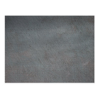 Bumpy surface of a sheet of slate gray postcard