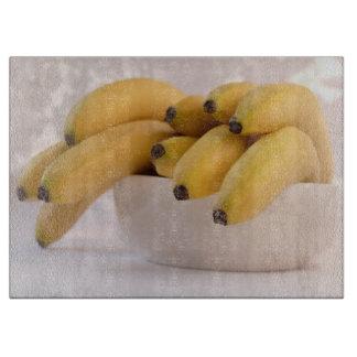 Bunch of bananas cutting board