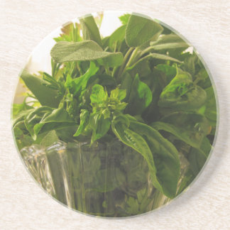 Bunch of fresh herbs from garden drink coaster