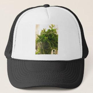 Bunch of fresh herbs from garden trucker hat