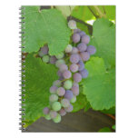 Bunch of purple grapes spiral note book