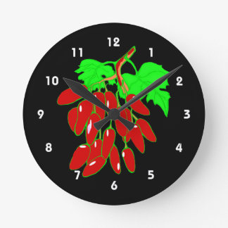 Bunch of red peppers round clock