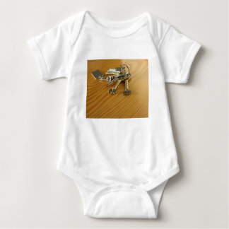 Bunch of worn house keys on wooden table baby bodysuit