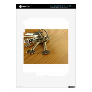 Bunch of worn house keys on wooden table decal for iPad 3