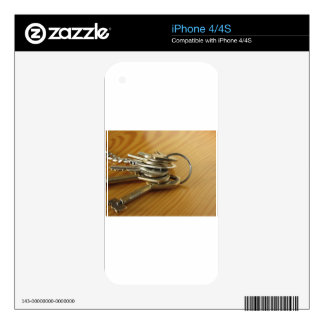 Bunch of worn house keys on wooden table decal for iPhone 4