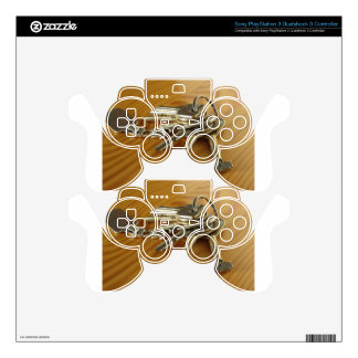 Bunch of worn house keys on wooden table decal for PS3 controller